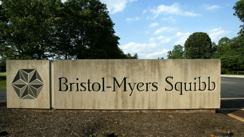 FILE - In this June 15, 2005, file photo, a sign stands in front of a Bristol-Myers Squibb building in a Lawrence Township, N.J. Bristol-Myers Squibb is buying Celgene in a cash-and-stock deal valued at about $74 billion. (AP Photo/Mel Evans, File)