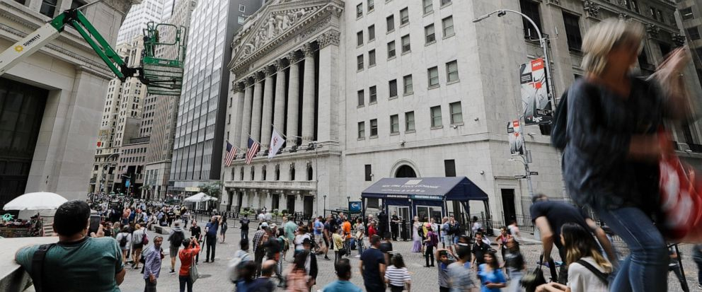 FILE - In this Aug. 23, 2019, file photo pedestrians pass the New York Stock Exchange in New York. The U.S. stock market opens at 9:30 a.m. EDT on Thursday, Oct. 3. (AP Photo/Frank Franklin II, File)