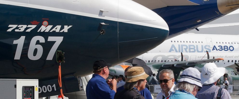 FILE - In this June 20, 2017, file photo Boeing planes displayed at Paris Air Show, in Le Bourget, east of Paris, France. Uncertainty over a Boeing jet and apprehension about the global economy hover over the aircraft industry as it prepares for next
