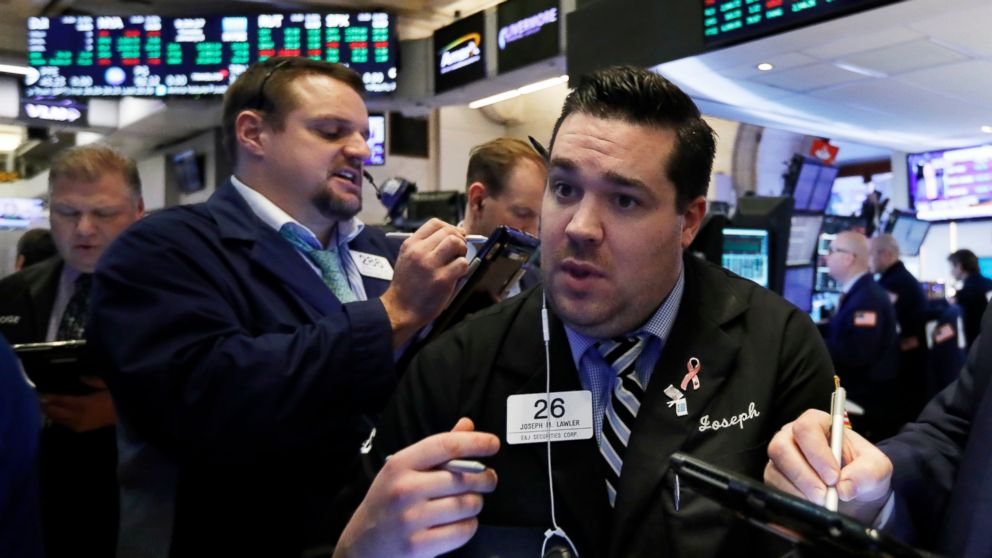 Joseph Lawler, right, works with fellow traders on the floor of the New York Stock Exchange, Tuesday, Jan. 8, 2019. Stocks are opening broadly higher on Wall Street, building on two days of solid gains. (AP Photo/Richard Drew)