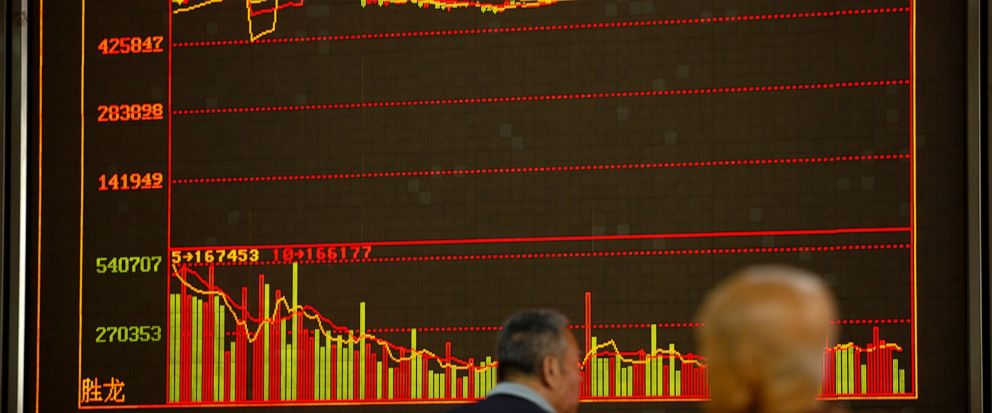 Chinese investors monitor stock prices at a brokerage house in Beijing, Wednesday, Sept. 11, 2019. Asian shares were mostly higher Wednesday, cheered by a rise on Wall Street amid some signs of easing tensions between the U.S. and China on trade issu
