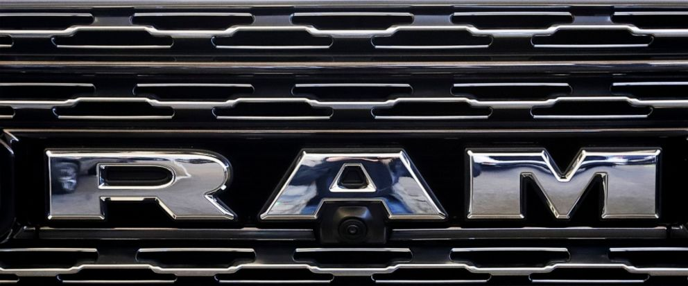 FILE - This Feb. 14, 2019, file photo shows the Ram logo on the front grill of a Ram 1500 at the 2019 Pittsburgh International Auto Show in Pittsburgh. Fiat Chrysler is adding more than 693,000 Ram pickups in the U.S. to a series of recalls to fix ta
