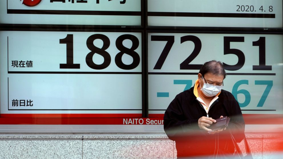 Asian shares mostly lower, Japan gains on upbeat data