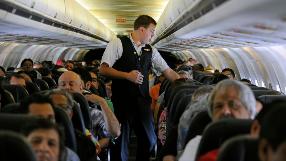 FILE- In this May 9, 2013, file photo, Allegiant Air flight attendant Chris Killian prepares his passengers for the Laredo, Tex, bound flight before it pushes back from the terminal at McCarran International Airport in Las Vegas. Smaller-company stocks like Allegiant Travel and Shutterfly have been soaring since late December and leading the rest of the market, a sharp reversal from much of the winter, when smaller stocks were plunging more than the rest of the market. (AP Photo/David Becker, File)