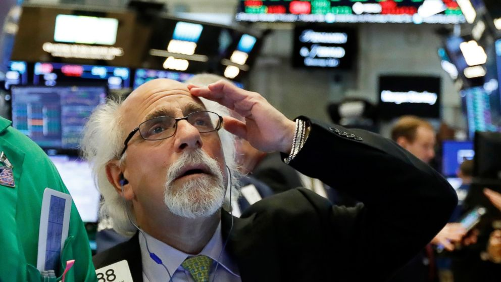 In this Tuesday, Jan. 29, 2019, file photo trader Peter Tuchman works on the floor of the New York Stock Exchange. The U.S. stock market opens at 9:30 a.m. EST on Friday, Feb. 8. (AP Photo/Richard Drew, File)