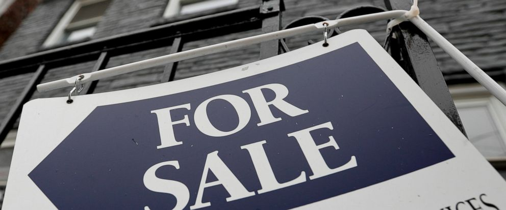 FILE - In this Jan. 4, 2019, photo a sign is displayed outside a house for sale in Pittsburghs Lawrenceville neighborhood. On Thursday, May 16, Freddie Mac reports on this week's average U.S. mortgage rates. (AP Photo/Keith Srakocic, File)