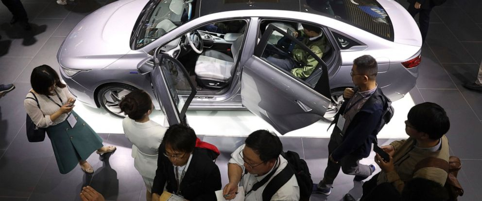 FILE - In this April 16, 2019, file photo, Chinese automaker Geely Auto displays a sedan from its new electric brand Geometry during the Auto Shanghai 2019 show in Shanghai. Chinas auto sales sank 17.7% in April from a year earlier, the 10th straigh