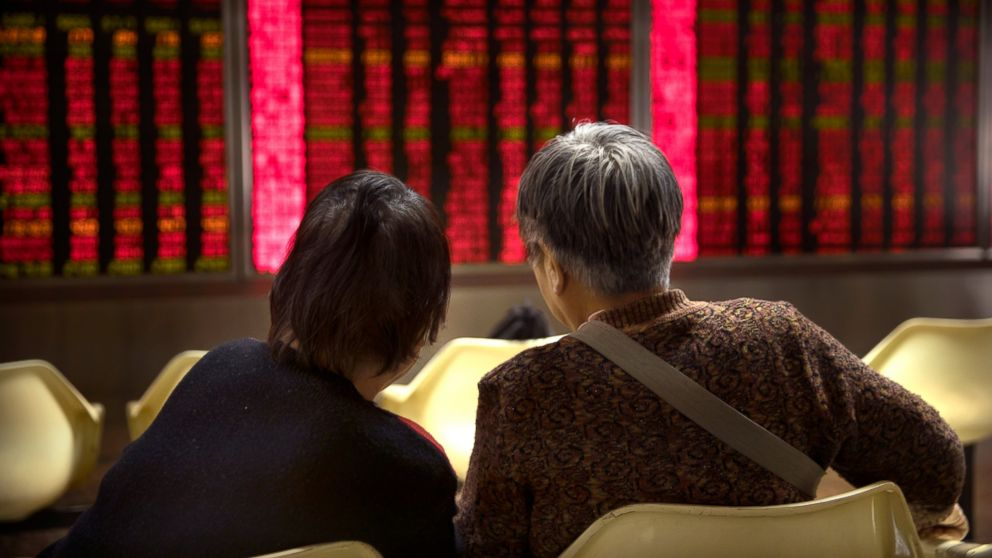 Chinese investors monitor stock prices at a brokerage house in Beijing, Wednesday, Feb. 27, 2019. Asian shares were higher in muted trading Wednesday as investors watch the second summit between President Donald Trump and North Korean leader Kim Jong Un in Vietnam. (AP Photo/Mark Schiefelbein)