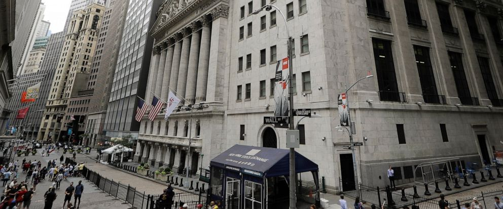 FILE - In this Aug. 23, 2019, file photo pedestrians pass the New York Stock Exchange in New York. The U.S. stock market opens at 9:30 a.m. EDT on Wednesday, Sept. 11. (AP Photo/Frank Franklin II, File)