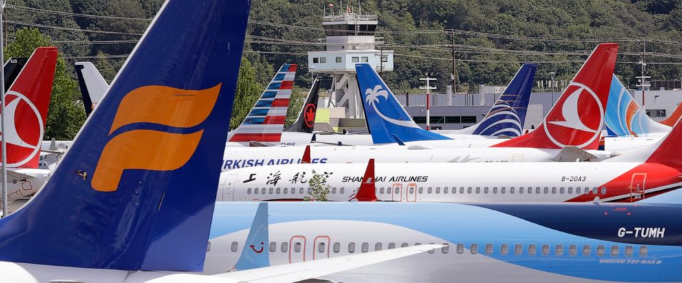 FILE - In this June 27, 2019, file photo, dozens of grounded Boeing 737 MAX airplanes crowd a parking area adjacent to Boeing Field in Seattle. Eric Lindblad, the executive who manages the Boeing 737 Max program and the Seattle-area factory where the
