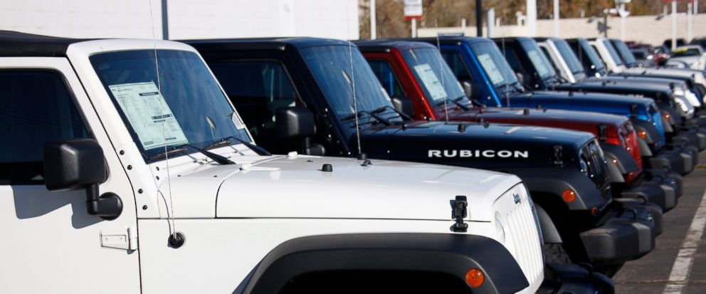 FILE- In this Nov. 1, 2009, file photo unsold 2010 Wranglers sit at a Chrysler/Jeep dealership in Englewood, Colo. Fiat Chrysler is recalling more than 1.6 million vehicles worldwide to replace Takata front passenger air bag inflators that can be dan