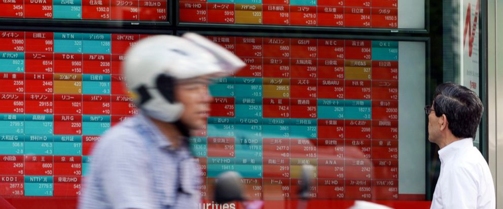 A man looks at an electronic stock board showing Japans Nikkei 225 index at a securities firm in Tokyo Thursday, Sept. 12, 2019. Asian shares were mixed Thursday after China moved to ease trade tensions. (AP Photo/Eugene Hoshiko)
