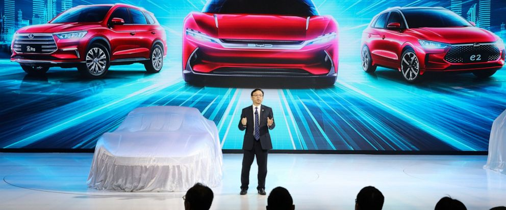 FILE - In this April 16, 2019, file photo, Wang Chuanfu, chairman and president of BYD Auto, the biggest global electric brand by sales volume, prepares to show the latest cars during the Auto Shanghai 2019 show in Shanghai. China's auto sales fell 7