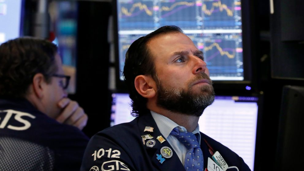 FILE- In this Jan. 3, 2019, file photo specialist Michael Pistillo, right, works on the floor of the New York Stock Exchange. The U.S. stock market opens at 9:30 a.m. EST on Wednesday, Jan. 9. (AP Photo/Richard Drew, File)