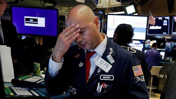 Asian stocks lower after US indexes tumble on recession fear