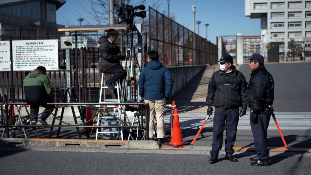 Security officials stand guard in front of Tokyo Detention Center, where former Nissan chairman Carlos Ghosn is detained, in Tokyo Friday, Jan. 11, 2019. Ghosn has recovered from a fever, his lawyer Motonari Ohtsuru said Friday as the 64-year-old executive's latest detention period was set to expire. (AP Photo/Eugene Hoshiko)
