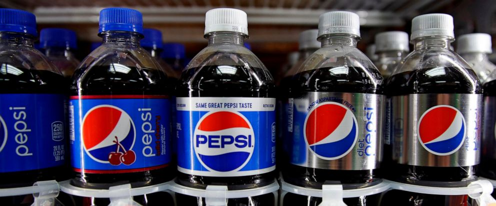 FILE - In this April 23, 2018, photo, Pepsi soft drink bottles are displayed at a store in Windham, N.H. PepsiCo Inc. reports earns on Tuesday, July 9, 2019. AP Photo/Charles Krupa, File)