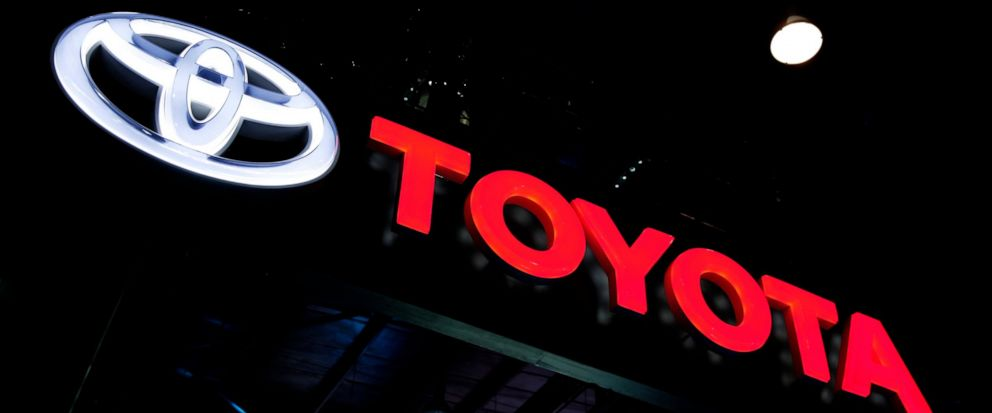 FILE - In this Feb. 7, 2018, file photo the logo of Toyota is displayed at the Auto Expo in Greater Noida, near New Delhi, India. Toyota said Wednesday, July 10, 2019, that it will scrap plans to build the Corolla compact car at a new factory under c