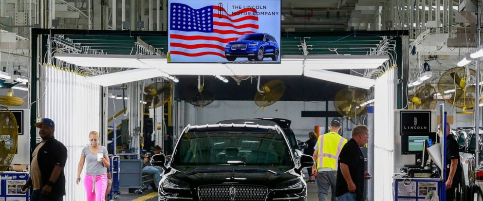 FILE - In this June 24, 2019, file photo Fords employees work on a Lincoln Aviator line at Fords Chicago Assembly Plant in Chicagos Hegewisch neighborhood. On Thursday, Aug. 15, the Federal Reserve reports on U.S. industrial production for July. (