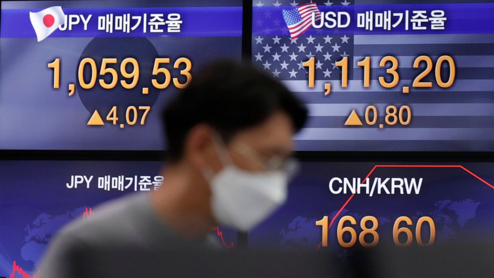 Asian shares drop amid worries over spreading COVID-19 cases