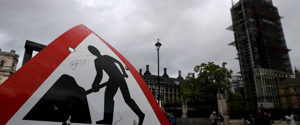 A road sign graffitied with the word Brexit in front of Britains Parliament in London, Friday, Sept. 27, 2019. U.K. interest rates could be cut even if the country avoids leaving the European Union on Oct. 31 without a deal, one of the Bank of Engla