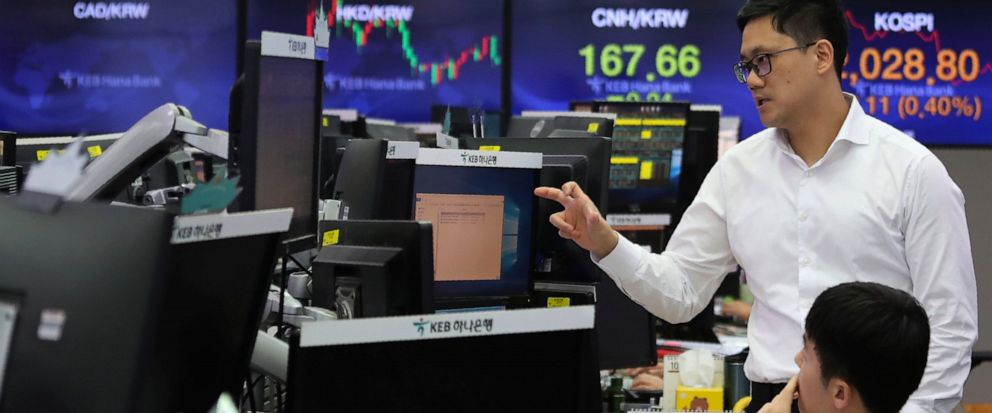 Currency traders work at the foreign exchange dealing room of the KEB Hana Bank headquarters in Seoul, South Korea, Monday, Oct. 7, 2019. Asian shares were mixed Monday, following a healthy report on U.S. jobs, while investors cautiously awaited the