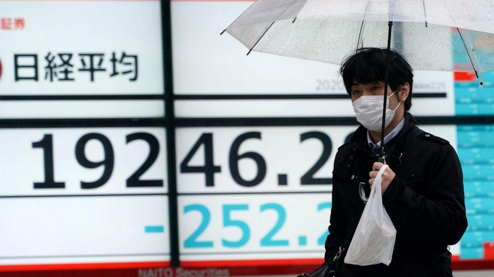 Stocks fall as investors brace for earnings hit from virus
