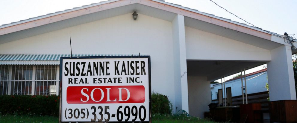 FILE - In this April 12, 2019, file photo, a sold sign is shown in front of a home in Surfside, Fla. On Thursday, June 13, Freddie Mac reports on this week's average U.S. mortgage rates. (AP Photo/Wilfredo Lee, File)