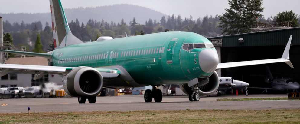 FILE - In this May 8, 2019, file photo a Boeing 737 MAX 8, being built for American Airlines, makes a turn on the runway as it is readied for takeoff on a test flight in Renton, Wash. American Airlines is now removing the Boeing 737 Max from its sche