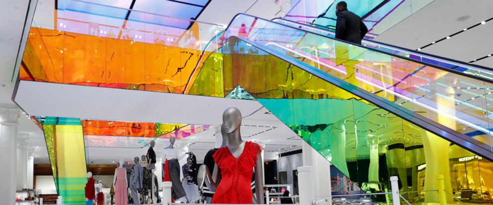 FILE - In this Feb. 20, 2019, file photo a mannequin wears a red dress inside the Saks Fifth Avenues flagship midtown Manhattan store in New York. A group of shareholders of Saks Fifth Avenues parent is making an offer to take the struggling depart