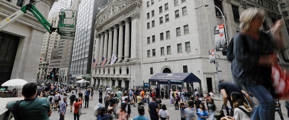 FILE - In this Aug. 23, 2019, file photo pedestrians pass the New York Stock Exchange in New York. The U.S. stock market opens at 9:30 a.m. EDT on Friday, Sept. 6. (AP Photo/Frank Franklin II, File)