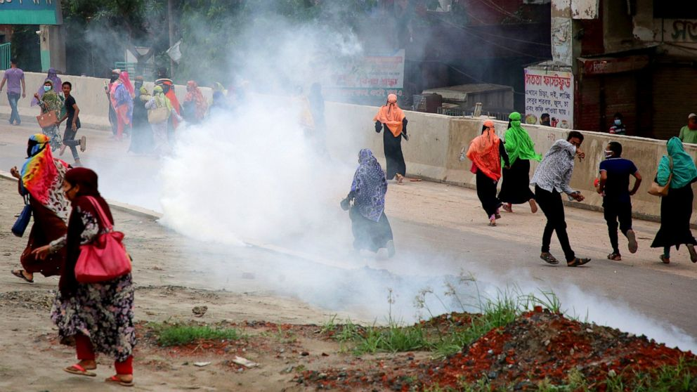 Bangladesh garment workers clash with police over wages