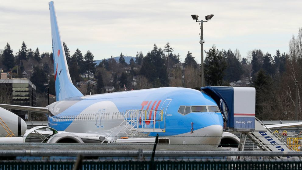 In this photo taken Monday, March 11, 2019, a Boeing 737 MAX 8 airplane being built for TUI Group sits parked at Boeing Co.'s Renton Assembly Plant in Renton, Wash. Britain, France and Germany on Tuesday joined a rapidly growing number of countries grounding the new Boeing plane involved in the Ethiopian Airlines disaster or turning it back from their airspace, while investigators in Ethiopia looked for parallels with a similar crash just five months ago. (AP Photo/Ted S. Warren)