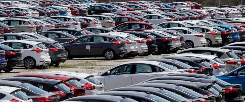 FILE - In this May 1, 2015, file photo Ford Focus vehicles are seen on a storage lot in Ypsilanti, Mich. Ford is extending the warranties on about 560,000 small cars to cover a litany of problems with a troubled six-speed automatic transmission. The