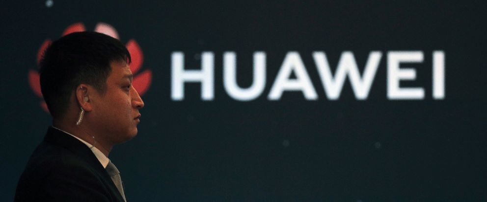 "In this Jan. 9, 2019, photo, a security guard stands near the Huawei company logo during a new product launching event in Beijing. The Chinese Foreign Ministry said late Friday, Jan. 11, 2019, it is ""closely following the detention of Huawei employee"