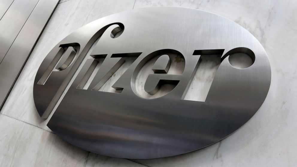 Pfizer swings to small profit as vaccines begin to roll out