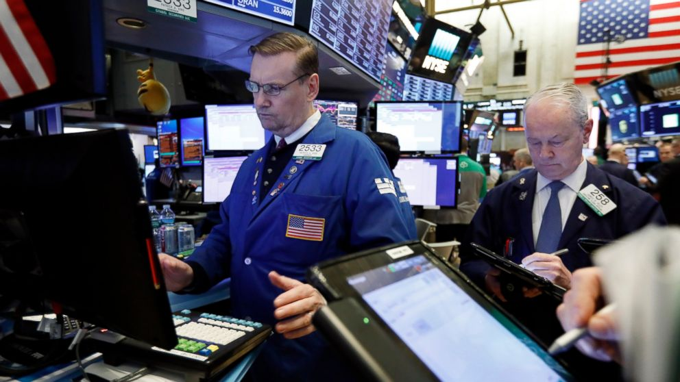FILE- In this Tuesday, Jan. 29, 2019, file photo specialist Patrick King, left, works on the floor of the New York Stock Exchange. The U.S. stock market opens at 9:30 a.m. EST on Wednesday, Feb. 6. (AP Photo/Richard Drew, File)
