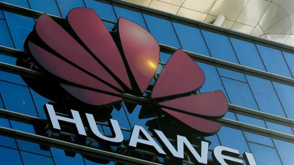 In this Dec. 18, 2018, photo, the logo of Huawei stands on its office building at the research and development centre in Dongguan in south China's Guangdong province. The U.S. Justice Department unsealed criminal charges Monday, Jan. 28, 2019 against Chinese tech giant Huawei, a top company executive and several subsidiaries, alleging the company stole trade secrets, misled banks about its business and violated U.S. sanctions. (AP Photo/Andy Wong)