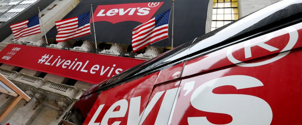 FILE- In this March 21, 2019, file photo a Levis banner adorns the facade of the New York Stock Exchange. Levi Strauss & Co. reports financial results on Tuesday, July 9. (AP Photo/Richard Drew, File)