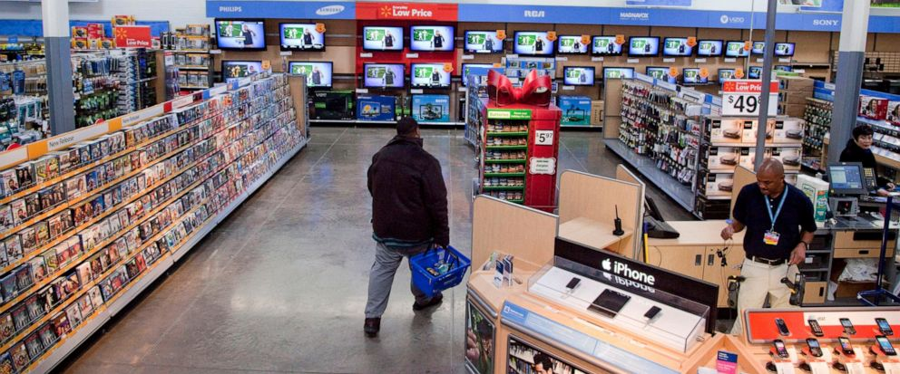 FILE = In this Dec. 15, 2010 file photo, a view of the entertainment section of a Wal-Mart store is seen in Alexandria, Va. Walmart is taking down all signs and displays from its stores that depict violence, following a mass shooting at its El Paso,