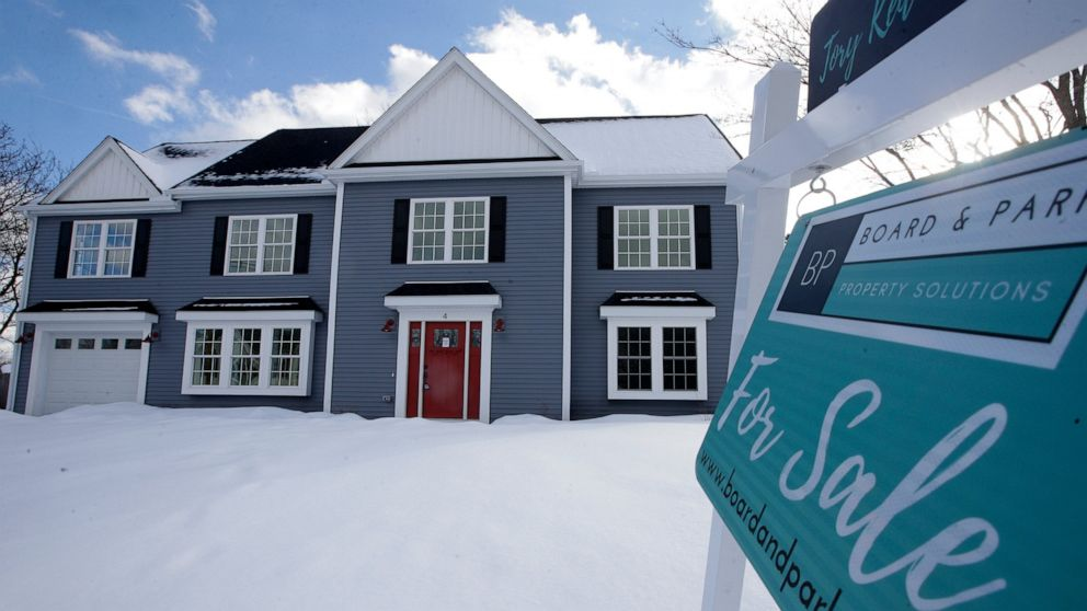 FILE- This Feb. 21, 2019, file photo shows a newly constructed home with a fore sale sign in Natick, Mass. On Thursday, April 11, Freddie Mac reports on this week's average U.S. mortgage rates. (AP Photo/Steven Senne, File)