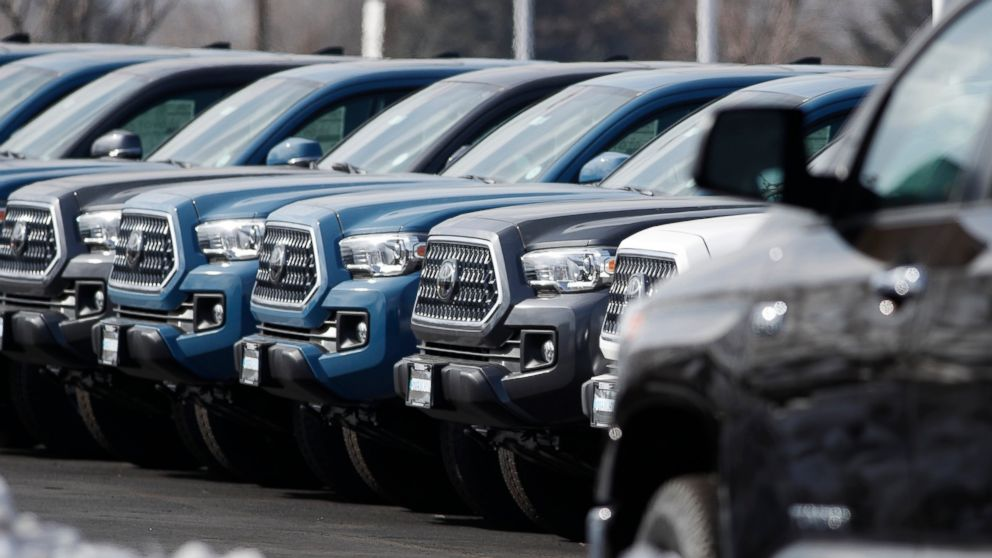 FILE- In this Wednesday, Feb. 27, 2019, file photograph, a long row of unsold 2019 Tacoma pickup trucks sits at a Toyota dealership in Lakewood, Colo. On Wednesday, March 13, the Commerce Department releases its January report on durable goods. (AP Photo/David Zalubowski, File)