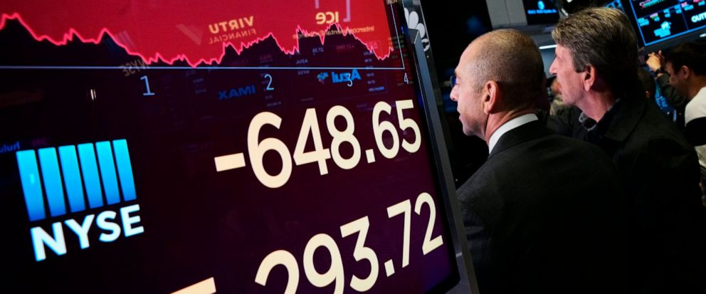An electronic screen shows the drop in the Dow Industrials, Monday, May 13, 2019 at the New York Stock Exchange. U.S. stocks moved sharply lower Monday on Wall Street and extended the markets slide into a second week as investors seek shelter from a