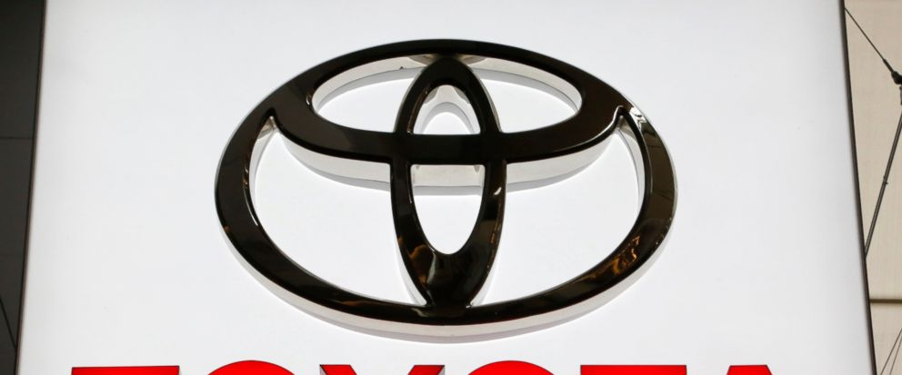 FILE- In this Feb. 15, 2018, file photo the Toyota logo displayed at the Pittsburgh Auto Show. Toyota is recalling 1.7 million vehicles in North America to replace potentially deadly Takata front passenger air bag inflators. The move announced Wednes