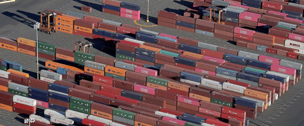 FILE - In this March 5, 2019, file photo, cargo containers are staged near cranes at the Port of Tacoma, in Tacoma, Wash. The 25% tariffs President Donald Trump has imposed on thousands of Chinese-made products have business owners trying to determin