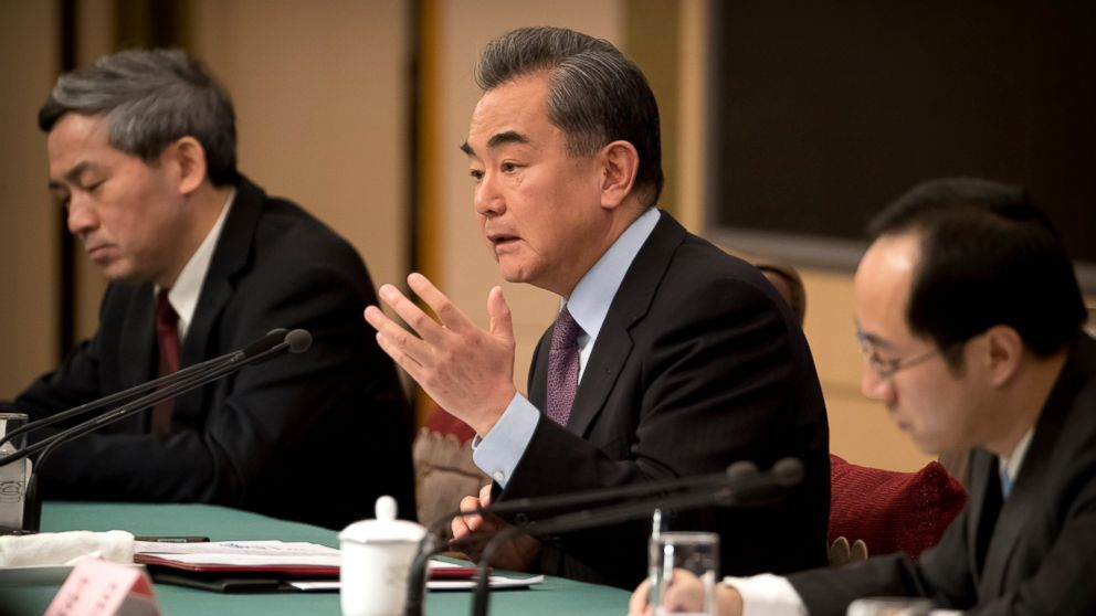 "Chinese Foreign Minister Wang Yi, center, speaks during a press conference on the sidelines of the annual meeting of China's National People's Congress (NPC) in Beijing, Friday, March 8, 2019. China's foreign minister says Beijing will ""take all necessary measures"" to defend its companies following legal conflicts between tech giant Huawei and the United States. (AP Photo/Mark Schiefelbein)"