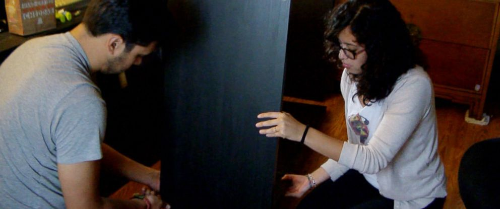 PHOTO: Stephanie Aguirre, 23, and Samuel Hidalgo, 29, assemble Ikea furniture as a part of couples therapy with Ramani Durvasula.