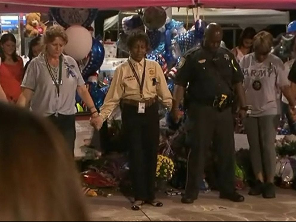 PHOTO: People can be seen gathering around Deputy Goforths shrine at the Chevron gas station where he was fatally shot in this screen grab on Sept. 6, 2015.