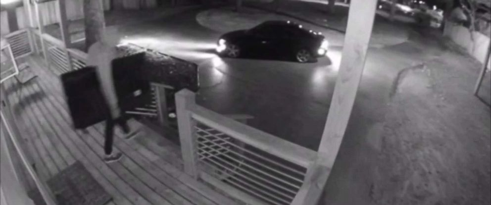 PHOTO: Surveillance video catches thieves stealing TVs from Airbnb rental.