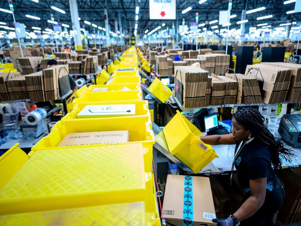 PHOTO: In this file photo taken on February 5, 2019 a woman works at a packing station at the 855,000-square-foot Amazon fulfillment center in Staten Island, New York.